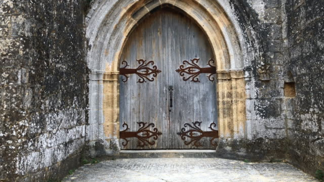 Old medieval door on old catholic church