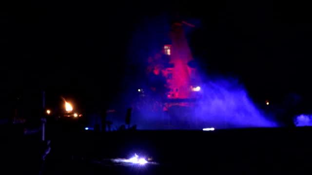 old mill illuminated laser light smoke at night laser show. FullHD video
