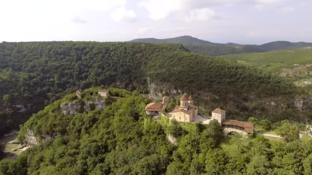 AERIAL. Old monastery hiding in the forests, also known as Motsameta, Georgia video