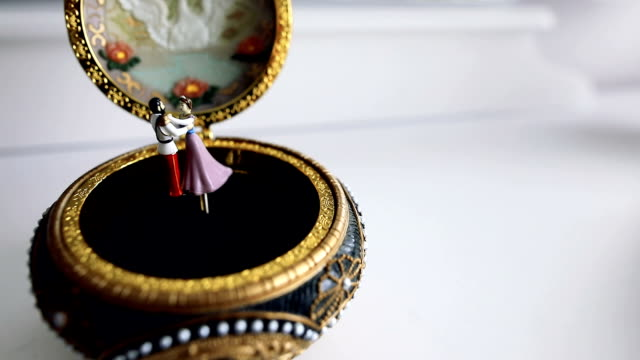Old music box with dancing rotating couple
