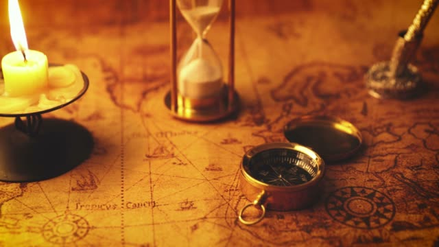 old nautical navigation items with candle on vintage map - candeliere video stock e b–roll