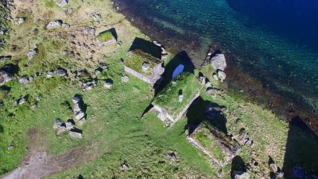 Old Norwegian settlement by lake, aerial view video