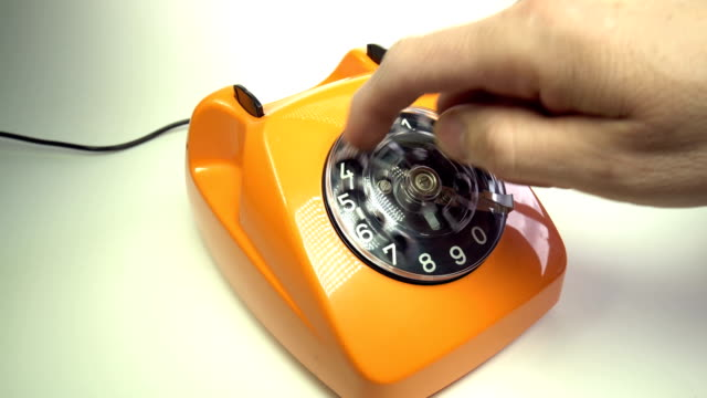 Old orange telephon Old orange telephon telefone stock videos & royalty-free footage