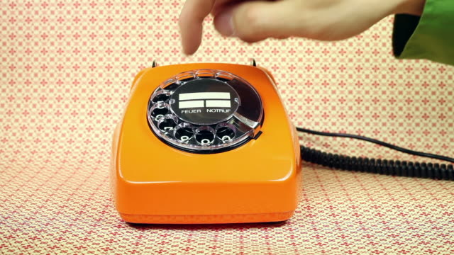 old orange telephone - dial phone number old orange telephone with wallpaper telephone receiver stock videos & royalty-free footage