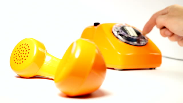 old orange telephone - dial phone number old orange telephone - dial phone number telephone receiver stock videos & royalty-free footage