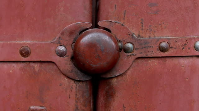 Old padlock. Old padlock on the door of the shed. Macro shot. keyhole stock videos & royalty-free footage
