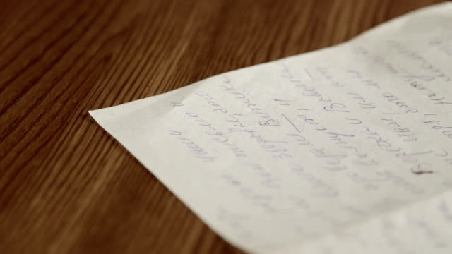 Old personal russian handwritten letter on wooden table close-up video