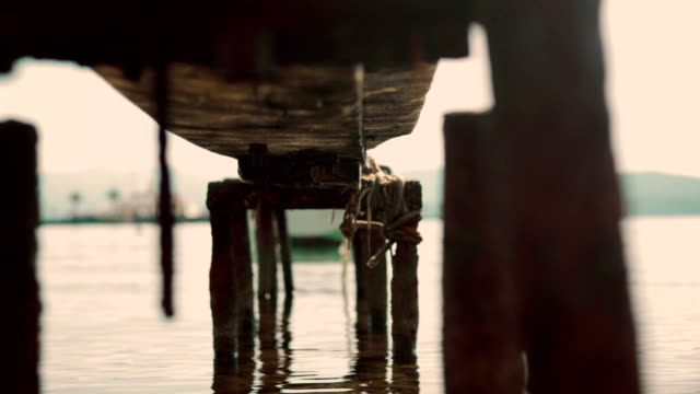 Old Pier Jetty on River with Water Sparkling in Bokeh as Beautiful Natural Background, 1920x1080 full HD footage video