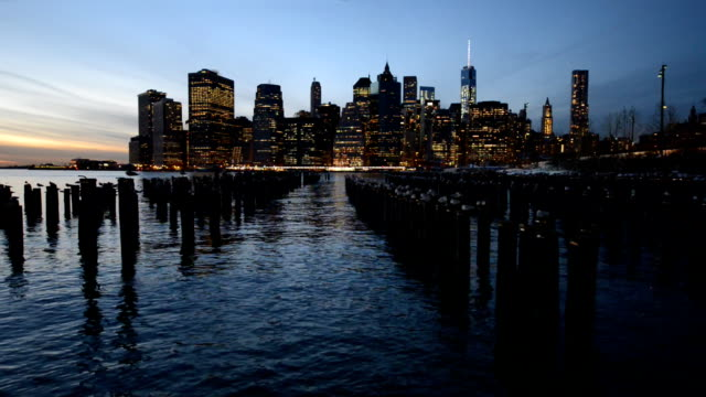 Old pier woods in Brooklyn and Manhattan skyline video