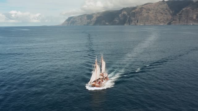 Old pirate ship sailing in the open ocean