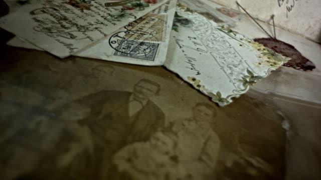 vídeos de stock, filmes e b-roll de cartões postais antigos, um recurso de história da família - fotografia imagem