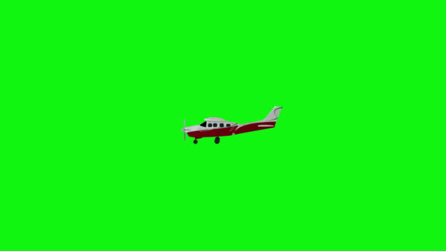 Old propeller plane flies from the right side of the screen to the left. Green screen footage