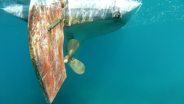 Old propeller Old fishing boat blade in the sea. propeller stock videos & royalty-free footage