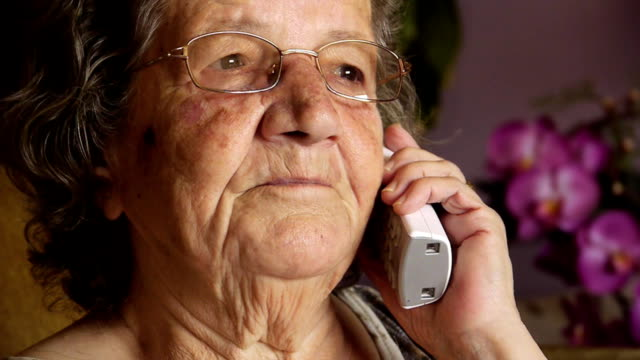 Old retired woman talking on telephone Old retired woman talking on telephone in home - Communication - Technology - Conversation - Full HD landline phone stock videos & royalty-free footage