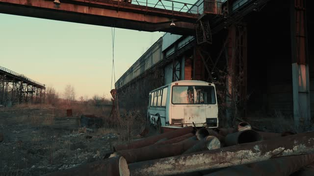 Old retro rusty broken abandoned bus in dark industrial post apocalyptic landscape video