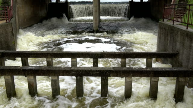 Old river dam water overflow after autumn rains video