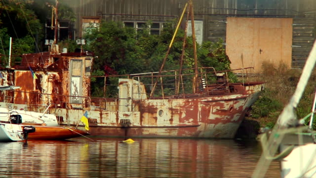 Old rusty ship in harbor, abandonment, destruction, wrecks