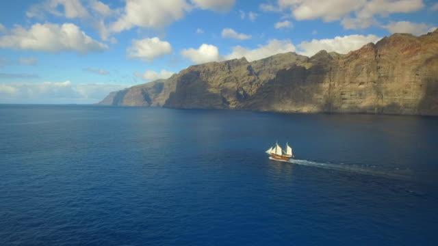 old sailing ship sails towards romantic adventures - ship stock videos & royalty-free footage