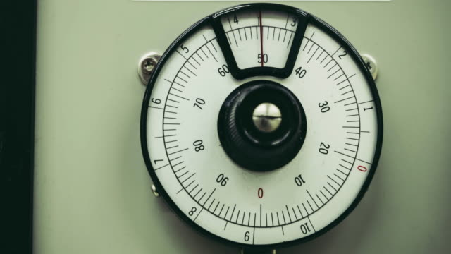 Old scale dial meter rotation from zero to ten round