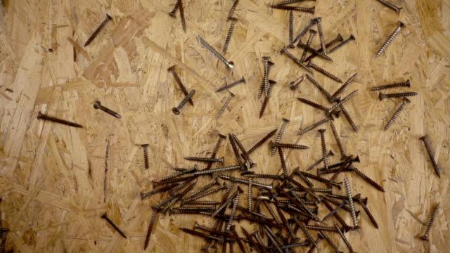 Old screws falling down on OSB board. video