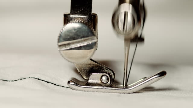 old sewing machine in work process - cucire video stock e b–roll