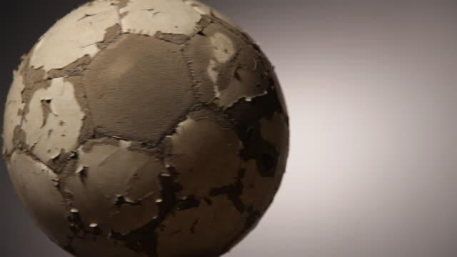 Old soccerball, seamless loop video