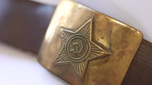 Old soldier's belt buckle with the symbols of the Soviet Union.