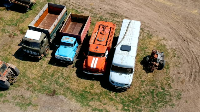 Old soviet trucks stand broken on the collective farm. Copter ( drone ) shooting