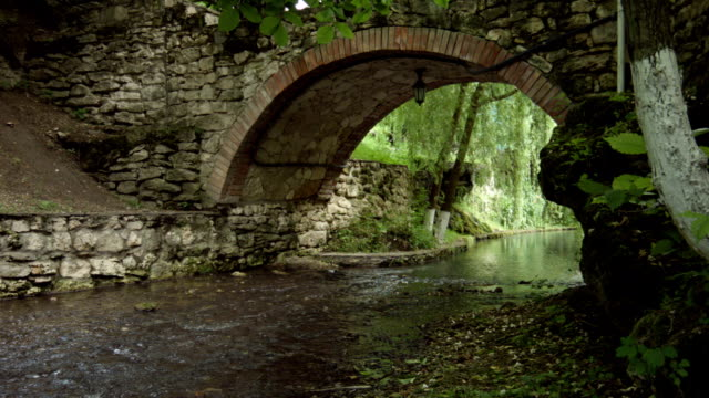Old Stone Arch Bridge on spring video