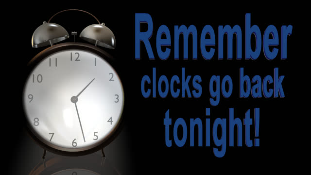 Old style alarm clock going back one hour An old style alarm clock going back one hour to mark the end of British Summer Time and the start of Greenwich Mean Time daylight savings stock videos & royalty-free footage