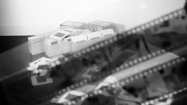 old style photography: selecting black and white film - diabild bildbanksvideor och videomaterial från bakom kulisserna