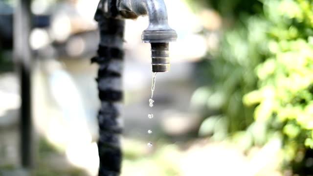 old tap closeup flowing waterdrop video