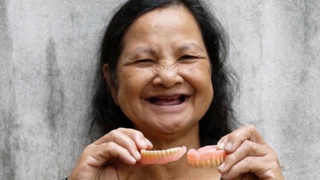Woman with false teeth