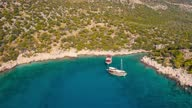 istock Old Tourist ship on the background of a mountain landscape on the Mediterranean sea. Excursion in Kekova, Kas, Turkey. Aerial view 4K. 1298882483