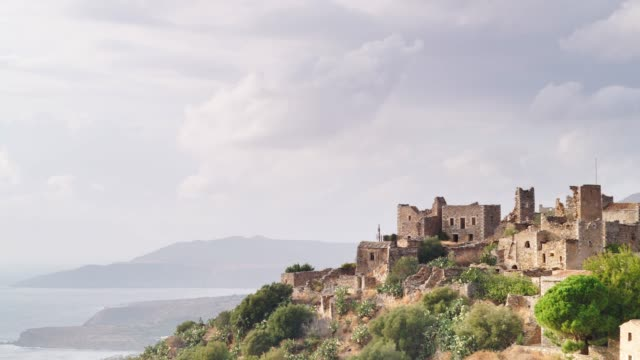 old tower houses in vathia greece mani peninsula time lapse - пелопоннес стоковые видео и кадры b-roll