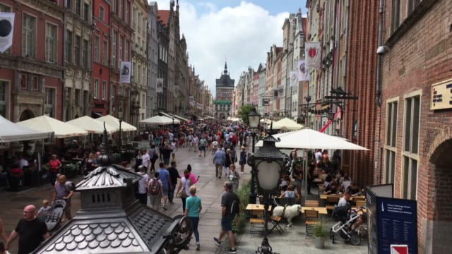 Old Town of Gdansk - Poland. Gdansk, Pomeranian, Poland - June 21, 2019: Old town of Gdansk with pedestrians in the Long market in front of the Golden Gate - Poland. gdansk stock videos & royalty-free footage