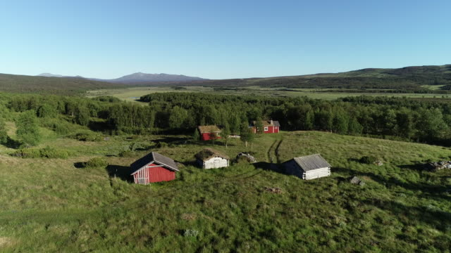 old traditional mountain village in the north of sweden - grass isolated video stock e b–roll
