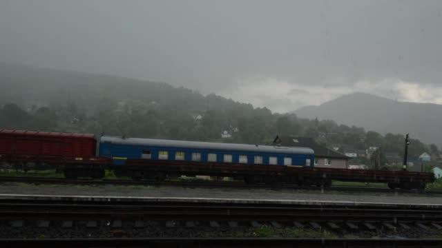 gamla tåg står på en landsbygden railroad station - karpaterna tåg bildbanksvideor och videomaterial från bakom kulisserna