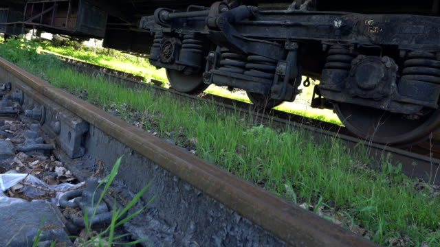 Old train wheel on a track. - vídeo