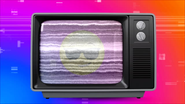 Old TV post showing a yellow emoji with glasses against a multi color background with TV sizzling Digital animation of an old TV post showing yellow emoji with glasses against a purple, blue and orange background with TV sizzling animation changing channels stock videos & royalty-free footage