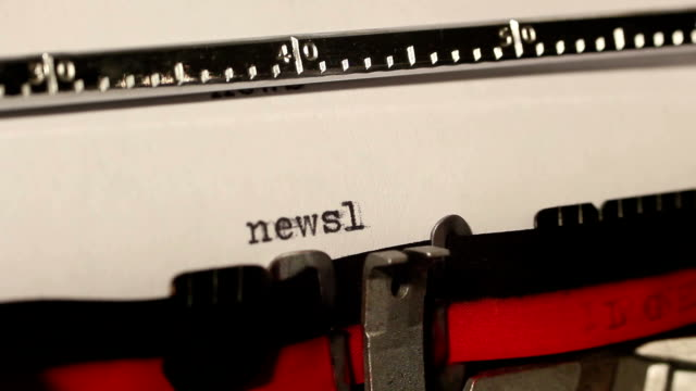 old typewriter write the word newsletter