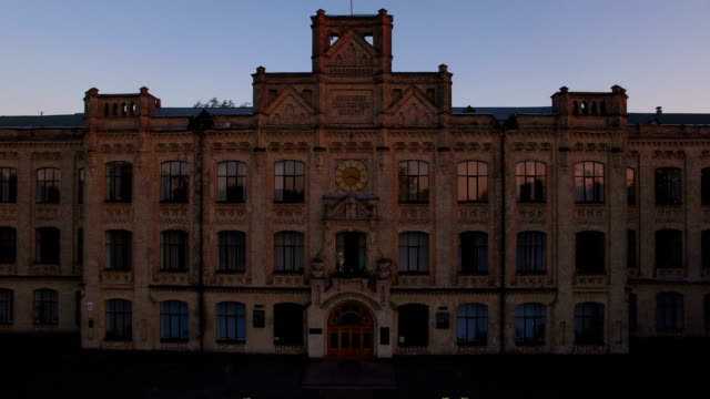 old university on the background of the city at sunset aerial - medieval architecture stock videos & royalty-free footage