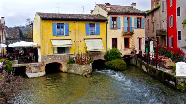 Old village on river. video