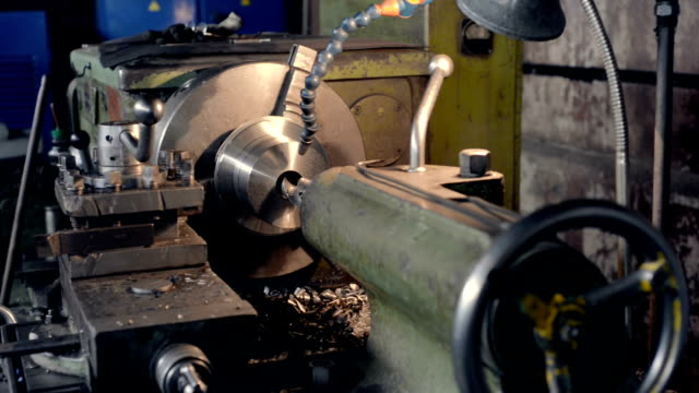 Old vintage lathe in the factory shop. video