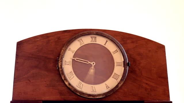 Old vintage mantel clock on white background video