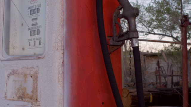 Old vintage red gas pump with analog counter dolly shot