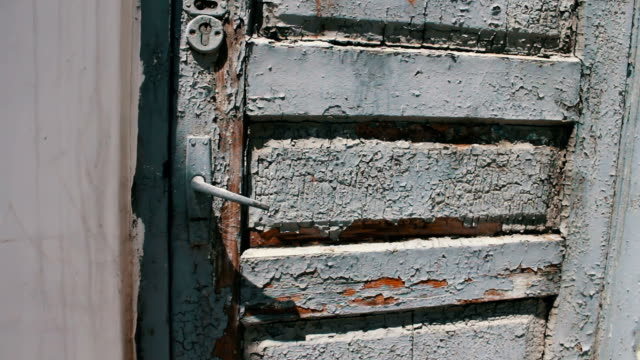 Old vintage wooden shabby with gray paint a front door on the street video