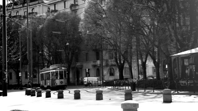 black and white video milan, italy- march 22, 2016: old vintage yellow tram №1881  atm class 1500 on the street of milan, italy . 502 cars were made in 1927-30 only - milan railway video stock e b–roll