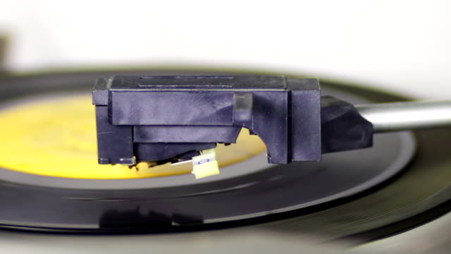 Old Vinyl Macro shot of old vinyl recording rotating in vintage player. Good for record player, gramophone, party, DJ, music, and more. Turntable On-Off. grooved stock videos & royalty-free footage