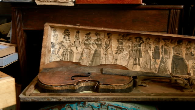 old violin without strings in poor condition video